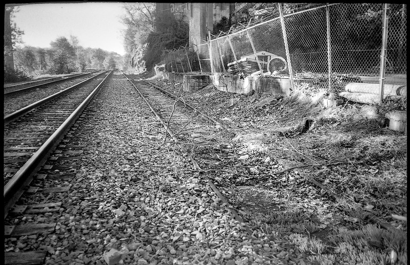 railroad tracks, wire fencing, overpass pillars, Asheville, NC, Olympus XA, Ilford FP4+, HC-110 developer, 4.21.19