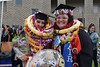 """Two graduates all smiles on the Great Lawn. The University of Hawaii–West Oahu held spring commencement on May 4, 2019 at the Lower Courtyard. View more photos on the UH West Oahu Flickr site at: <a href=""""https://www.flickr.com/photos/uhwestoahu/albums/72157678118707327"""">www.flickr.com/photos/uhwestoahu/albums/72157678118707327</a>"""