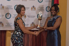 A recipient receives her award.