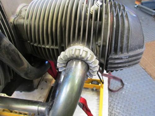 Aluminum Header Nut Screws Onto The Exhaust Port of the Head
