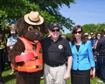 Photo of Splash the Water Safety Dog, Governor Larry Hogan and Natural Resources Secretary Jeannie Haddaway-Riccio