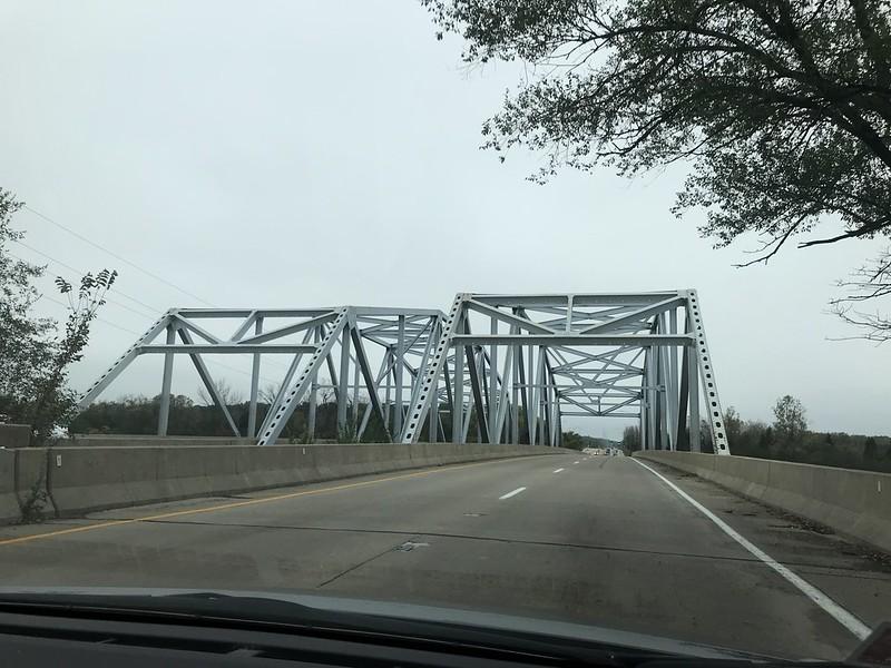 Doubled steel truss bridges