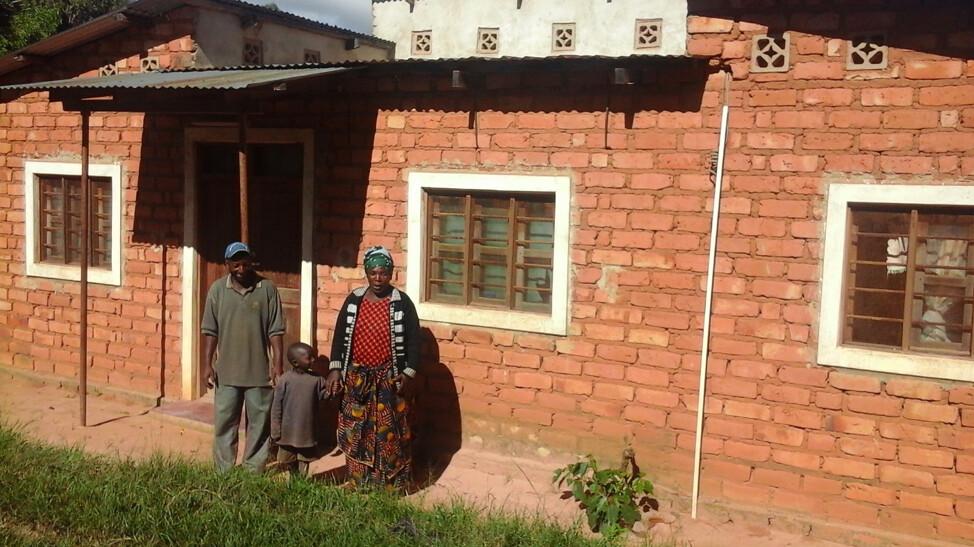 Method Magoda and his family outside their house at Utengule Village in Kilolo District. Photo credit: Frednand Japhet/IITA.