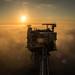 Sunrise, Cloud Inversion and Oil Platform