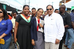 Prime Minister, Hon. Moses Nagamootoo takes a photo with Bartica's Radio Personality, Carlita Williams and another Resident of Region 7.