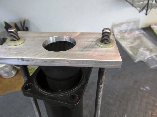 Flat Washers and Coupling Nuts Secure Wider Plate to Threaded Rods