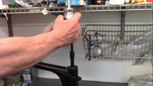 Attach Slide Hammer to Expanding Sleeve and Pull Up Sharply A Couple Times