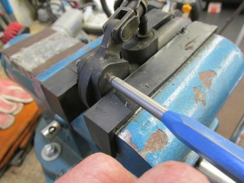 Use Drift To Drive Out Pin Of Actuating Lever Assembly