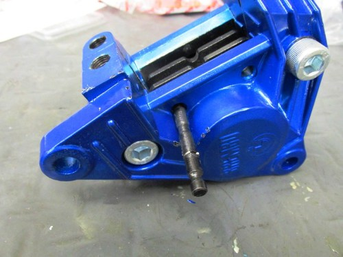 Long Pin Pushes In From Front Side of Caliper-Start From End With Brake Pipe & Bleed Valve Holes