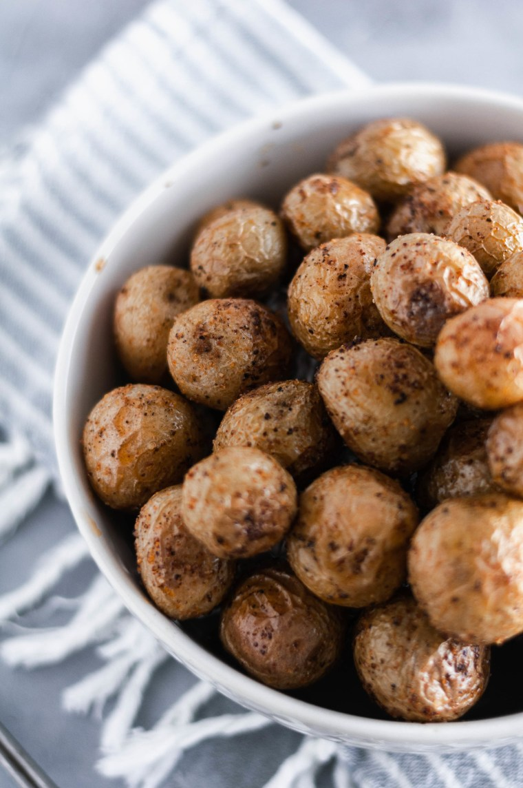 These Roasted Teeny Tiny Taters - a simple side dish using Trader Joe's teeny tiny taters. Only a handful of ingredients and 30 minutes needed.