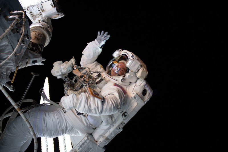 Astronaut Andrew Morgan waves during a spacewalk