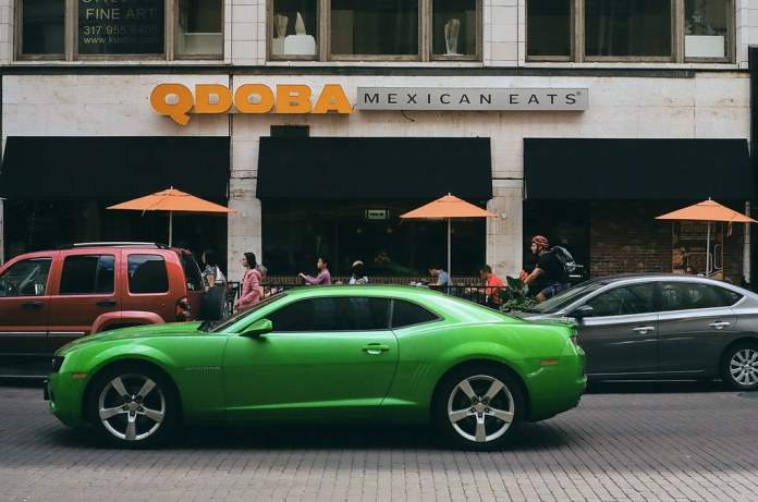 Green car at Qdoba