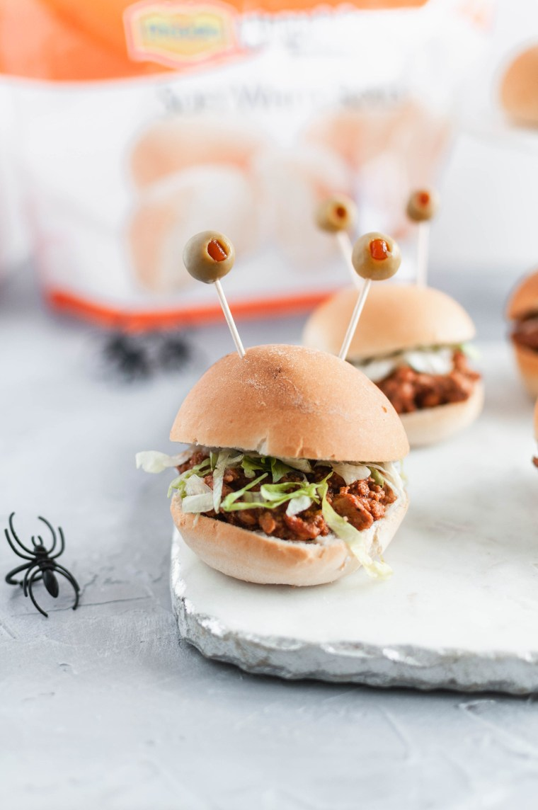 Celebrate Halloween with Rhodes and these spooky Halloween Sliders. Pimento stuffed olives make creepy monster eyes atop these taco sliders.