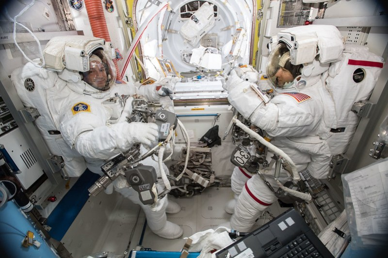 NASA astronauts Andrew Morgan and Christina Koch are suited up in U.S. spacesuits