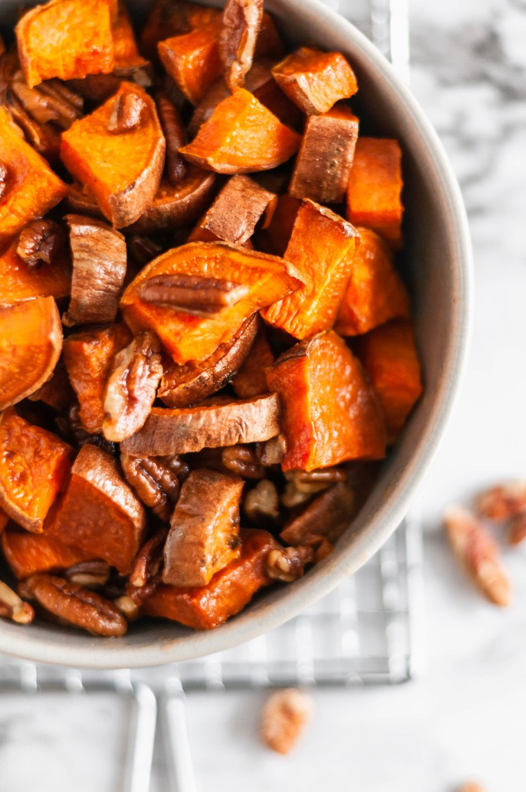 These Roasted Sweet Potatoes with buttery pecans are the perfect simple and easy side dish to add to your holiday menu. Less than 40 minutes from start to finish and you'll have sweet, tender, crunchy, buttery goodness on your dinner table.