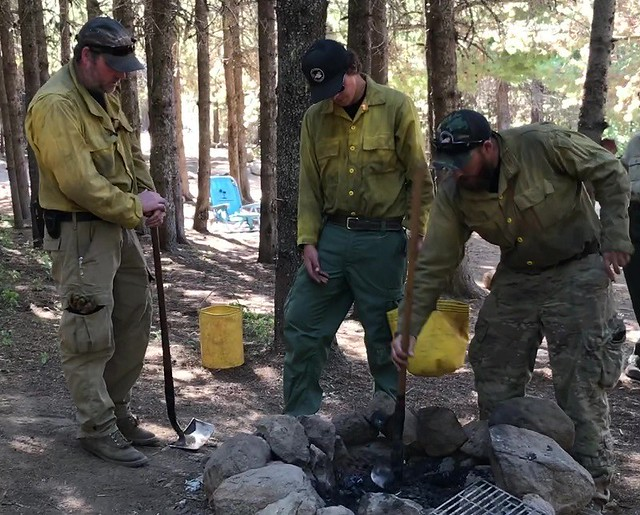 Mt Hood National Forest Fire Staff drown a campfire that was left unattended in 2019.