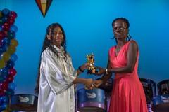 A graduate receives her certificate.
