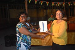 Minister within the Ministry of Indigenous People's Affairs, Hon. Valerie Garrido-Lowe donates a tablet to the village.