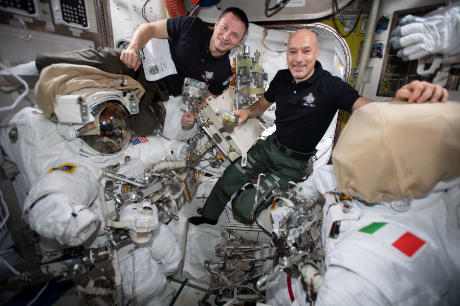 Astronauts Andrew Morgan and Luca Parmitano check U.S. spacesuits and spacewalking tools