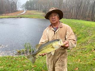 Photo of man holding a largemouth bass.