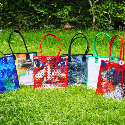 Upcycled tote bags made from tarpaulin banners hung around UP Sunken Garden during CANVAS annual outdoor banner exhibit
