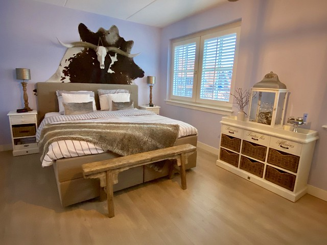 Slaapkamer landelijk dierenvel muur