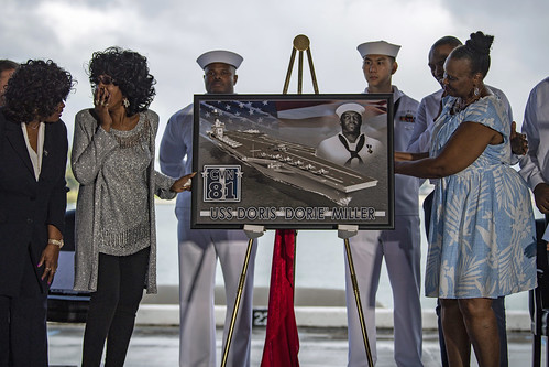 Family of Doris Miller react after the unveiling of a framed graphic commemorating the naming of USS Doris Miller (CVN 81). (U.S. Navy/MC2 Justin R. Pacheco)