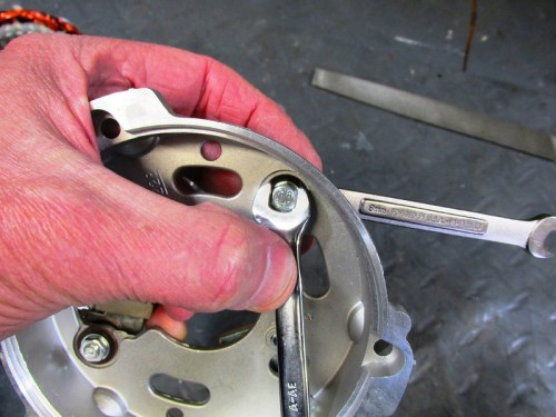 "Tightening Stator Cover ""Y"" Terminal Bolt and Locking Nut"