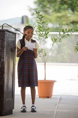 A pupil of the New Diamond/Grove Primary School recites a poem