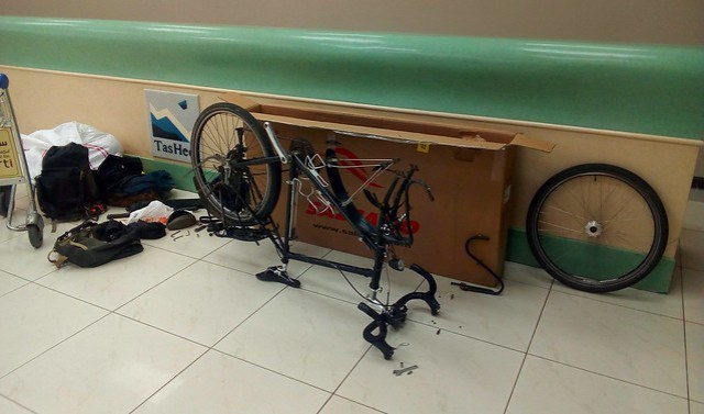 Building my bike at the Jeddah airport by bryandkeith on flickr