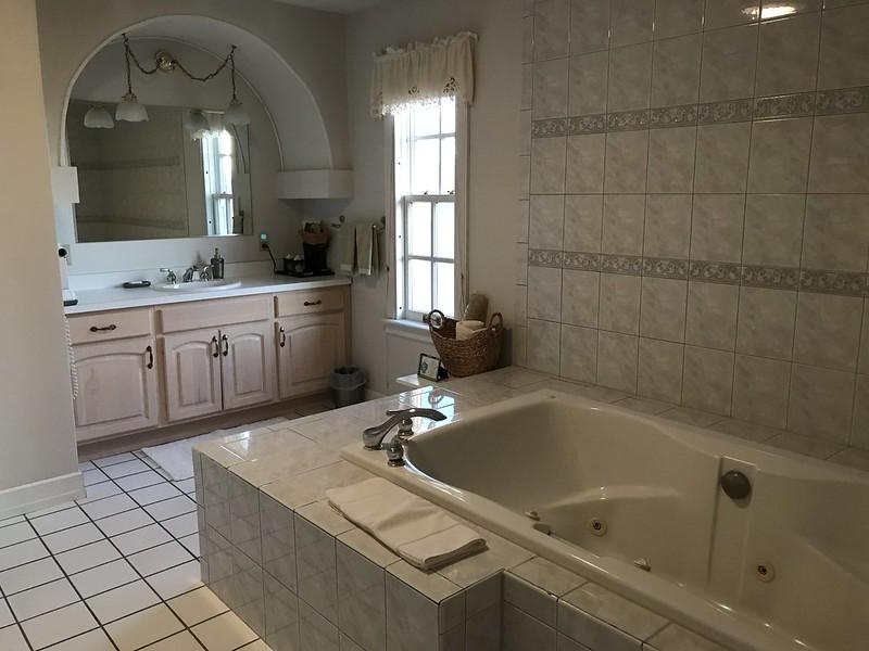 Bath with whirlpool