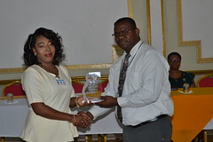 A Community Health Worker receives an award