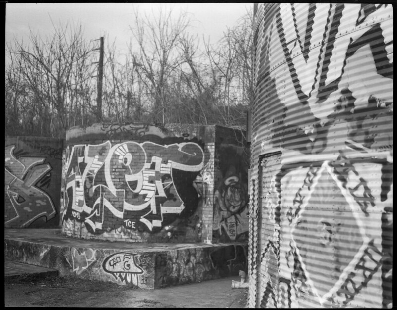 urban landscape, decay, storage silos, graffiti, River District, Asheville, NC, Koni Omega  Rapid 200, Super Omegon 90mm f-2.8, early March 2020