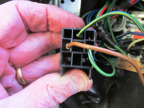Bottom of Turn Signal Relay Connector Plug with BROWN Ground Wire Plugged Into It