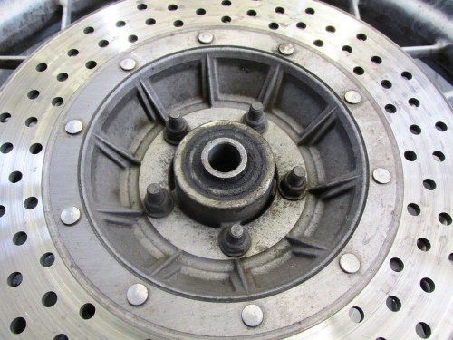 Left Side Disk Brake Rotor Has Locking Nuts
