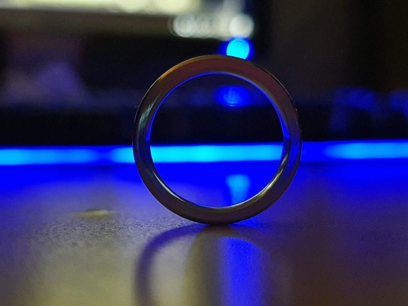 Metal ring against a blue keyboard background