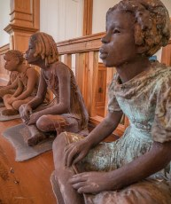 Each statue represents a named child slave.