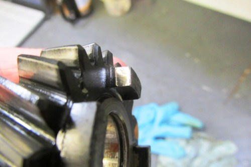 "Output Shaft 5th Gear Dog Tooth Face ""Shiny"" Side on Acceleration Side Of Tooth"