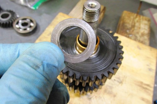 Output Shaft 1st Gear Washer Next To Rear Ball Bearing-Sharp Side Faces Away From 1st Gear
