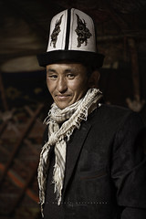 Kyrgyz man with a traditional hat in Seki. Pamir Mountains, Afghanistan.
