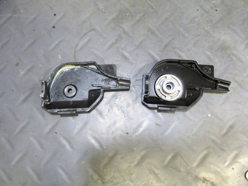 Earlier (Left) and Later (Right) Throttle Cam Covers With Different Size Cam Bushings
