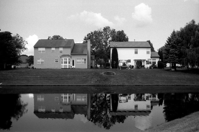 Reflected houses, underexposed