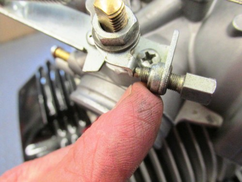 Throttle Stop Screw Contacts Lever Arm When Throttle Is Closed