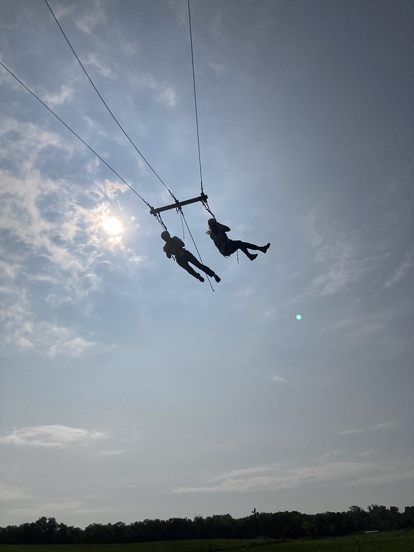 Athena and Kristine Scalzi in the sky, on a swing.