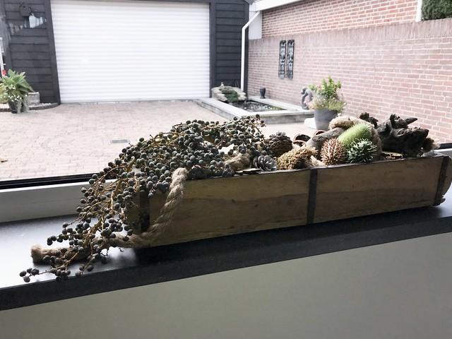Dadeltak en herfstdecoratie in steenmal