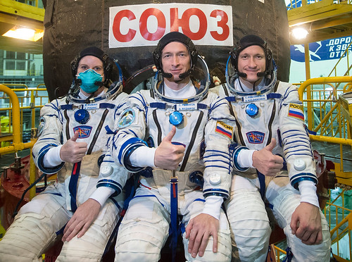 Expedition 64 crew poses during a Soyuz MS-17 spacecraft fit check