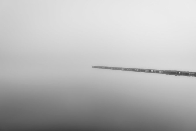 Jetty on a Foggy Lake