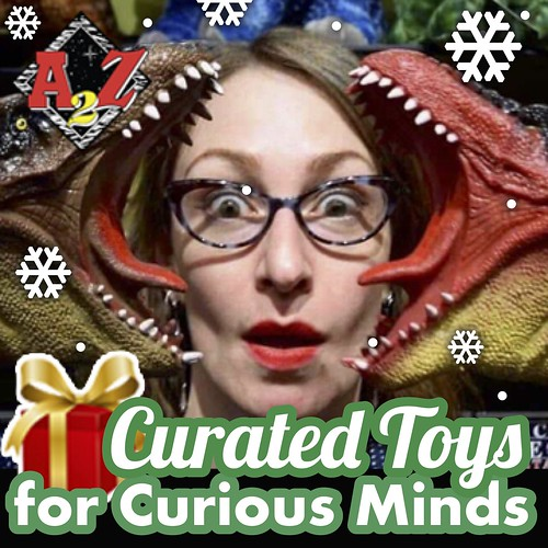 "Graphic with background of a person wearing glasses surrounded by toy dinosaurs and the words ""Curated Toys for Curious Minds"" overlay."