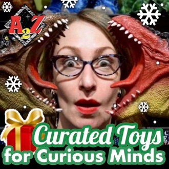 "Graphic with image of a person surrounded by toy dinosaurs with the words ""Curated Toys for Curious Minds"" overlay."