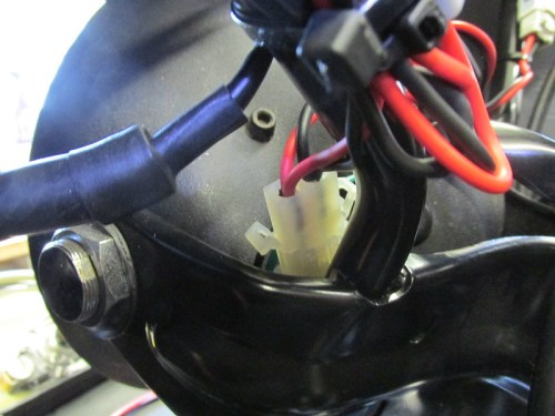 Plug With Headlight Leads Tucked Between Headlight And Bracket